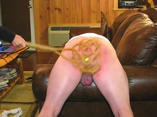 My mistress spanking me with carpet beater