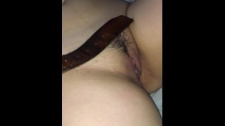 Spanking her pussy with my belt